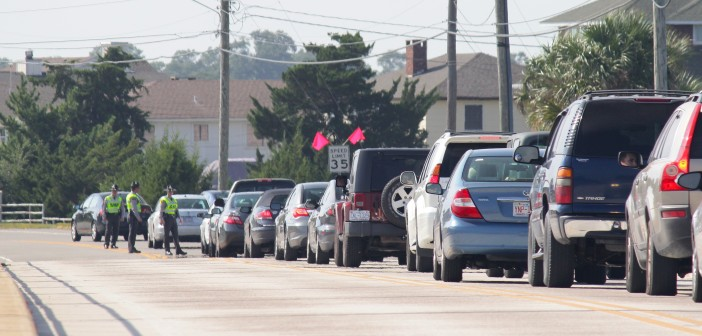 Troopers with North Carolina State Highway Patrol stop drivers leaving Wrightsville Beach during a license check on Labor Day, Monday, Sept. 1.