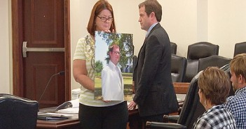 Supplied image courtesy of WECT. Beverly Tyler holds a photo of her son, Zachary Paul Tyler, during the trial of Judith Margaret Nemeth Monday, Sept. 22 at the New Hanover County Courthouse. Nemeth was sentenced to serve 13-25 months in prison after pleading guilty to the charges of misdemeanor death by motor vehicle and felony hit and run for the June 13, 2013, which resulted in the death of Zachary Tyler.