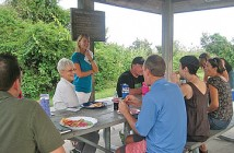 Staff photo by Susan Miller. Project leader Ginger Taylor speaks to Wrightsville Beach -- Keep It Clean volunteers during the end-of-season appreciation dinner Sunday, Sept. 14 in Wrightsville Beach Park.