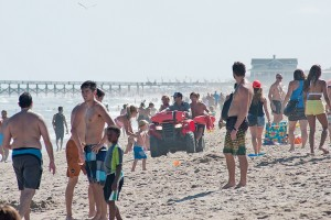 Staff photo by Allison Potter. Wrightsville Beach Ocean Rescue patrols the crowded beach strand Sunday, Aug. 31.