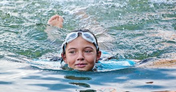 Staff photo by Emmy Errante, Eight-year-old Neale McIntyre finishes the open water swim Saturday, Aug. 30 in Motts Channel.