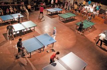 Staff photo by Emmy Errante. Players compete in table tennis matches at the Fourth Port City Ping-Pong Throwdown at the Brooklyn Arts Center Friday, Sept. 5.