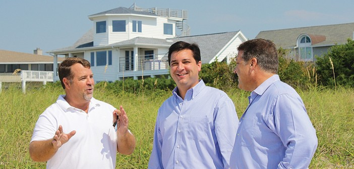 Staff photo by Cole Dittmer. Wrightsville Beach town manager Tim Owens, left, shows North Carolina 7th Congressional District candidate David Rouzer and U.S. Representative Bill Shuster, R-Pennsylvania, Masonboro Inlet and the jetty system Friday, Aug. 29.