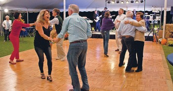 Staff photo by Emmy Errante. Guests dance to music by Heartbeat of Soul during the 2014 Airlie Gardens Oyster Roast Friday, Oct. 17.
