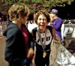 Photograph courtesy of Laura Hull. Laura Hull celebrates at the finish line with her daughter, Lynne, after finishing the PPD Beach2Battleship Ironman Triathlon Saturday, Oct. 25.