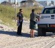 Town of Wrightsville Beach park ranger Shannon Slocum, right, assists Wrightsville Beach Police Department officers with the investigation of a deceased male found on Wrightsville's beach strand around 8:30 a.m. Friday, Oct. 17, near Public Beach Access No. 31.