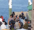 "Film crews shoot scenes of ""The Choice"" on the Hanover Seaside Club's sounded dock Monday, Oct. 20."