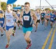 Staff photo by Emmy Errante. Dylan Skinner runs in the 2014 Son Run at Wrightsville Beach Park Saturday, Oct. 18.