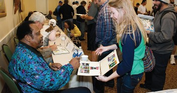Lumina News file photo. Courtney Adams receives an autograph from retired Major League Baseball player Al Oliver at the 10th Annual Willie Stargell Celebrity Golf Tournament Meet the Stars Nov. 9, 2013 at the Landfall Park Hampton Inn and Suites.