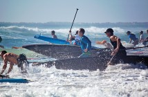 Lumina News file photo. Competitors race into the ocean for the start of the men's division of the North Carolina Surf to Sound Challenge in Wrightsville Beach Nov. 16, 2013.
