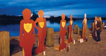 Staff photo by Allison Potter. Female forms representing victims of domestic abuse in North Carolina stand at the downtown Wilmington waterfront Thursday night, Oct. 9, during the Take Back the Night March and Rally. The Silent Witnesses memorial was created by the North Carolina Coalition Against Domestic Violence.