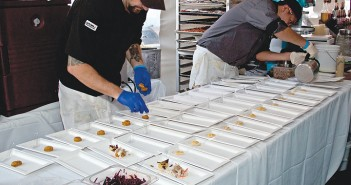 Staff photo by Emmy Errante. Sweet and Savory head chef Josh Petty plates sweet potato biscuits during the third annual Taste of Wrightsville Beach Saturday, Oct. 11 at MarineMax.