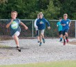 Staff photo by Allison Potter. Web Eckel, from left, Walker Duncan and Joca Trecco run the track at Wrightsville Beach School Monday morning, Oct. 20 as part of the WBS Get Up & Move Club.