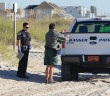 Staff photo by Cole Dittmer. Town of Wrightsville Beach park ranger Shannon Slocum, right, assists Wrightsville Beach Police Department officers with the investigation of a deceased male found on Wrightsville's beach strand around 8:30 a.m. Friday, Oct. 17, near Public Beach Access No. 31.