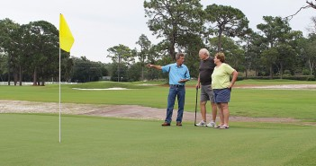 Staff photo by Cole Dittmer. David Donovan, Wilmington Municipal Golf Course manager and head pro, shows Wilmington residents Dave and Linda Crowell the completed renovations of the course Monday, Sept. 29.