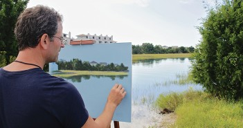 Staff photo by Cole Dittmer. En plein air artist Christopher Reid paints Kenan Creek Friday, Oct. 10, as part of the Wrightsville Beach Museum of History's inaugural plein air art show and wet paint sale.