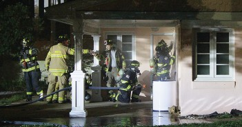 Staff photo by Cole Dittmer. Firefighters with Wrightsville Beach Fire Department complete a simulated fire attack training exercise Wednesday, Sept. 24, at a home on the south end of the island set to be demolished.