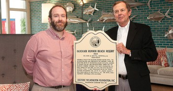 Staff photo by Allison Potter. Gareth Evans, left, executive director of the Bellamy Mansion Museum, presented Bill Baggett, co-owner of the Blockade Runner Beach Resort, with a Historic Wilmington Foundation plaque Sunday, Nov. 9.