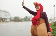 Staff photo by Allison Potter. Nancy Faye Craig waves to approaching vehicles on Causeway Drive to promote the Street Turkeys of Wilmington project Wednesday, Nov. 26. Groups from the Wrightsville United Methodist Church sponsor the food drive to help supply the Food Bank of Central and Eastern North Carolina at Wilmington.