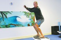 Staff photo by Cole Dittmer. 100 Percent Fitness owner Patrick Smith demonstrates the capabilities of the SurfSet Fitness system in his studio Monday, Nov. 10.