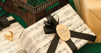 Staff photo by Allison Potter. Luxe Home Interiors Lead Designer Julie Bray reused old sheet music as wrapping paper.