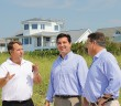 Wrightsville Beach town manager Tim Owens, left, shows North Carolina 7th Congressional District candidate David Rouzer and U.S. Representative Bill Shuster, R-Pennsylvania, Masonboro Inlet and the jetty system Aug. 29.