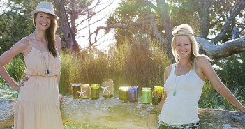 Supplied photo by D.J. Struntz. CaroLuna Candleworks owners Kate Struntz, right, and sister Brooks Inglese produce handmade soy wax candles in recycled wine bottles from local restaurants.