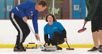 Staff photo by Emmy Errante. Tony Jacobs and Anita Dingler curl at the Wilmington Ice House Friday, Dec. 5.