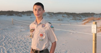 Staff photo by Allison Potter. Dominic Iannucci planned and installed a new border of posts and rope at the Mason Inlet Waterbird Management Area to earn the rank of Eagle Scout.