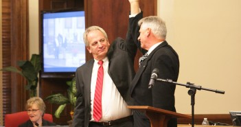 Newly elected New Hanover County Commissioners Skip Watkins and Rob Zapple celebrate their first commissioners meeting Monday, Dec. 22.