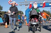 Staff photo by Emmy Errante. Joanne Harcke, left, and others showed their holiday spirit with festive attire for the Jingle Bell Run Saturday, Dec. 13.