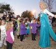 Staff photo by Emmy Errante. Children dance with Elsa during movie night in the park in Wrightsville Beach Park Saturday, Dec. 13.