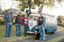 Staff photo by Allison Potter. Phillip Nadeau, from left, Steve Martinez, Jason Ward and Steve Fawcett of the Oil and Air VW Club of Wilmington collect donations for Toys for Tots during the club's inaugural Stuff the Bus event Saturday, Dec. 13 at the Pub at Sweet n Savory.