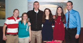Staff photo by Emmy Errante. Firefighter of the year Calvin Smith, Kimberly Hatcher, Kyle Miess, Kayla Thompson, Rebecca Wilkins and Garrett McQueen attend the annual Wrightsville Beach Fire Department dinner Saturday, Dec.13 at 22 North.