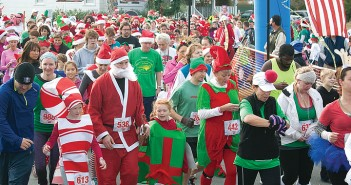 Lumina News file photo. Participants dressed in costumes begin the Jingle Bell 5K Run to benefit the Wrightsville Beach Museum of History Dec. 14, 2013.