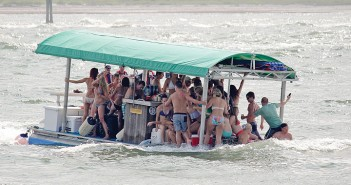 Lumina News file photo. A pontoon boat carrying around 25 passengers takes on water across its bow from heavy wakes in Masonboro Inlet Fourth of July, 2014.