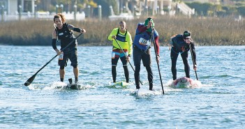 Staff photo by Emmy Errante. Jeremy Whitted, Corey Taylor, Kevin Rhodes and Chris Norman paddle through Motts Channel during the second lap of the Cold Stroke Classic's elite course Saturday, Jan. 17.