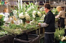 Staff photo by Cole Dittmer. Floral stylists with Julia's Florist create arrangements Friday, Jan. 23. Julia's Florist is one of the founding members of the Small Business for Film organization.
