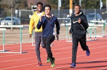 Staff photo by Emmy Errante. Rian Fowler, Zac Harris and Maurice Holmes, freshmen on the University of North Carolina Wilmington track and field team, run sprints during practice Monday, Jan. 26.
