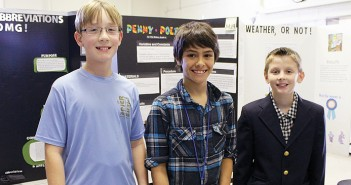 Staff photo by Cole Dittmer. Wrightsville Beach School students Cooper Hyldahl, from left, Riis Weber and Bryce Petit placed first, second and third, respectively, in the school science fair and will represent WBS in the New Hanover County Science Fair Jan. 22.