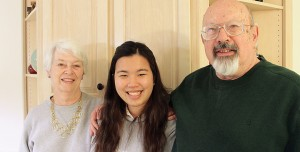 Staff photo by Cole Dittmer. Richard and Marsha Roush stand with Thai exchange student Ratima Jamjod, who the Roushes are hosting for a full school year through International Culture Exchange Services.
