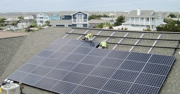 Supplied photo courtesy of Cape Fear Solar Systems. Cape Fear Solar Systems installs panels on the roof of The Surf Club in Wrightsville Beach.