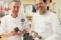 Staff photo by Cole Dittmer. Country Club of Landfall executive chef Olivier Andreini, left, stands with Italian chef Carlo Zarri and a plate full of truffles Zarri brought from his home in Cortemilia, Italy, for a series of dinners in the United States.