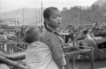 "This 1957 photo of a young Chinese girl with her baby sibling is one of several on display as part of the ""Nagasaki to Normandy"" exhibit."