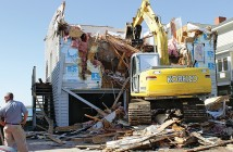 Lumina News file photo, Crews work to demolish a house at 462 Causeway Dr. Oct. 16, 2014 to make way for the construction of a new home on the site.