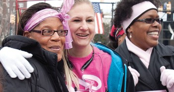 Lumina News file photo. Breast cancer survivors share a moment before the start of the Susan G. Komen Race for the Cure March 1, 2014 in downtown Wilmington.