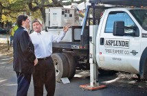 Staff photo by Emmy Errante. Alderman Hank Miller and Wrightsville Beach Mayor Bill Blair observe tree trimming efforts on Live Oak Drive by Duke Energy Tuesday, March 17.