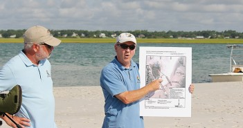 Lumina News file photo. North Carolina Coastal Federation coastal advocate, Mike Giles, right, and executive director Todd Miller present the possible impacts of a terminal groin on the north end of Figure Eight Island on location July 2, 2014.
