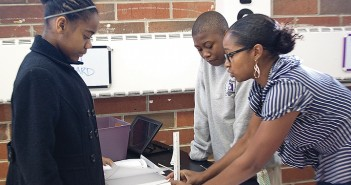 Lumina News file photo. Shemeka Shufford helps Rebekah Williamson and Jerry Blanks construct a STEM curriculum project at D.C. Virgo Dec. 12, 2014. The North Carolina Holiday Flotilla board plans to donate funds to the STEM program through sponsorships again this year.