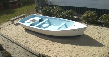 The newly refurbished Simmons Skiff. Photo courtesy Wrightsville Beach Museum of History.